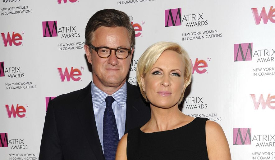 """In this April 22, 2013, file photo, MSNBC's """"Morning Joe"""" co-hosts Joe Scarborough and Mika Brzezinski, right, attend the 2013 Matrix New York Women in Communications Awards at the Waldorf-Astoria Hotel in New York. (Photo by Evan Agostini/Invision/AP, File)"""