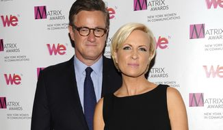 """In this April 22, 2013 file photo, MSNBC's """"Morning Joe"""" co-hosts Joe Scarborough and Mika Brzezinski, right, attend the 2013 Matrix New York Women in Communications Awards at the Waldorf-Astoria Hotel in New York. (Photo by Evan Agostini/Invision/AP, File)"""