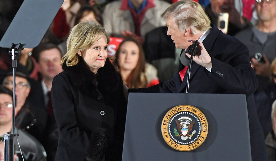 President Donald Trump greets Sen. Cindy Hyde-Smith, R. Miss., during a rally in Tupelo, Miss., Monday, Nov. 26, 2018. (Associated Press)