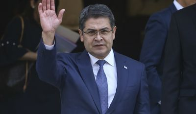 President of Honduras Juan Orlando Hernandez waves as he exitsthe Academia Diplomatica de Chile where he met with President-elect Sebastian Pinera, in Santiago, Saturday, March 10, 2018.  Hernandez is in Chile to attend Sunday's presidential inauguration ceremony for Pinera, who led Chile from 2010-2014. (AP Photo/Esteban Felix)