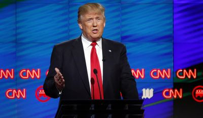 Republican presidential candidate, businessman Donald Trump,  speaks during the Republican presidential debate sponsored by CNN, Salem Media Group and the Washington Times at the University of Miami,  Thursday, March 10, 2016, in Coral Gables, Fla. (AP Photo/Wilfredo Lee)