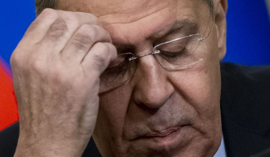Russian Foreign Minister Sergey Lavrov attends a joint news conference with his Dominican Republic counterpart Miguel Vargas following their talks in Moscow, Russia, Monday, Nov. 26, 2018. Regarding the incident where a Russian coast guard fired on three Ukrainian boats Sunday and then seized them along with the crews Lavrov said Monday that Ukraine has violated international law and provoked Russia by sending its navy vessels through the Kerch Strait without permission. (AP Photo/Alexander Zemlianichenko)