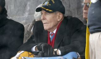 FILE - In this April 1, 2017 file photo, Korean War veteran Thomas Hudner looks on during the christening ceremony for the future USS Thomas Hudner, a U.S. Navy destroyer named in his honor, at Bath Iron Works in Bath, Maine. The ship will be commissioned Saturday, Dec. 1, 2018 in Boston. (AP Photo/Mary Schwalm, File)