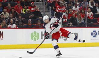 Columbus Blue Jackets right wing Josh Anderson (77) shoots against Detroit Red Wings goaltender Jimmy Howard in the first period of an NHL hockey game Monday, Nov. 26, 2018, in Detroit. Anderson scored on the play. (AP Photo/Paul Sancya)