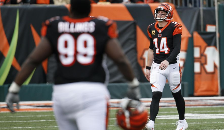 Cincinnati Bengals quarterback Andy Dalton (14) walks off the field after possibly injuring his hand following a failed attempt to recover a fumble in the second half of an NFL football game against the Cleveland Browns, Sunday, Nov. 25, 2018, in Cincinnati. (AP Photo/Frank Victores)