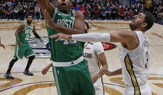 New Orleans Pelicans forward Nikola Mirotic (3) attempts to block Boston Celtics center Al Horford (42) at the basket in the first half of an NBA basketball game in New Orleans, La. Monday, Nov. 26, 2018. (Max Becherer/The Advocate via AP)