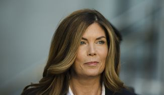 FILE - In this Monday, Oct. 24, 2016, file photo, former Pennsylvania Attorney General Kathleen Kane arrives at Montgomery County courthouse for her sentencing hearing in Norristown, Pa. The Pennsylvania state Supreme Court on Monday, Nov. 26, 2018, announced it will not review Kane's conviction for leaking grand jury information and lying about it, and the Montgomery County district attorney's office said it plans to ask a judge the following morning to revoke her bail. (AP Photo/Matt Rourke, File)