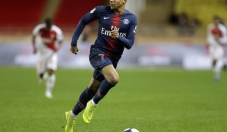 PSG's Kylian Mbappe runs with the ball during the French League One soccer match between AS Monaco and Paris Saint-Germain at Stade Louis II in Monaco, Sunday, Nov. 11, 2018 (AP Photo/Claude Paris)