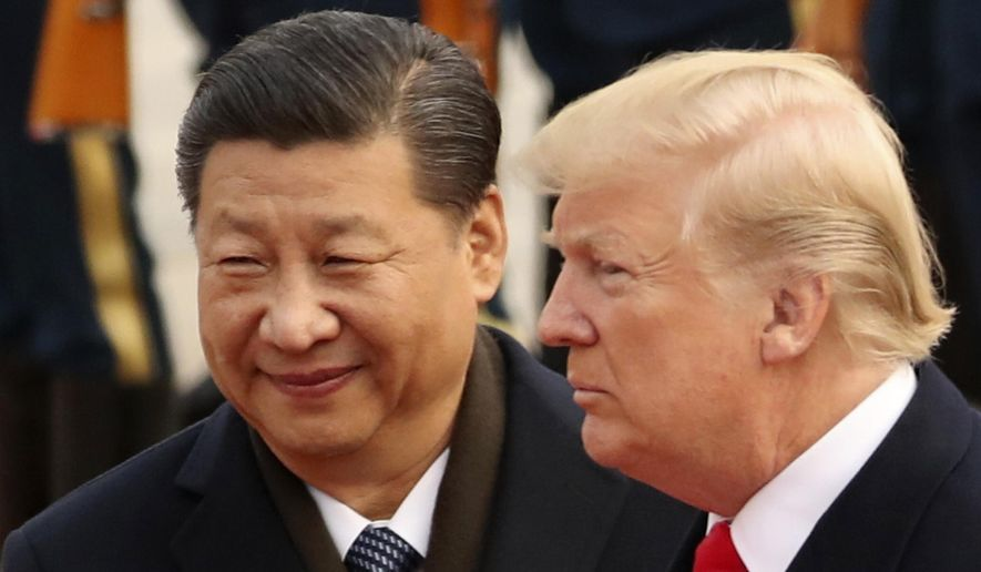 In this Nov. 9, 2017, file photo, U.S. President Donald Trump and Chinese President Xi Jinping participate in a welcome ceremony at the Great Hall of the People in Beijing, China. Trump is to meet with Xi at the Group of 20 summit in Buenos Aires, Argentina, on Friday, Nov. 30, and Saturday, Dec. 1. (AP Photo/Andrew Harnik, File) ** FILE **