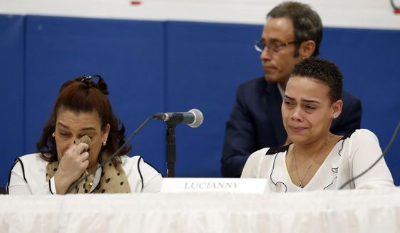 As her mother Rosaly wipes away a tear, Lucianny Rondon, sister of Leonel Rondon, the young man killed in the Sept. 13, 2018, Merrimack Valley gas explosions, pauses while making a statement during a hearing on gas pipeline safety in the Merrimack Valley Monday, Nov. 26, 2018, in Lawrence, Mass. (AP Photo/Winslow Townson)