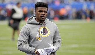 FILE - In this Oct. 28, 2018, file photo, Washington Redskins running back Chris Thompson (25) warms up before an NFL football game against the New York Giants in East Rutherford, N.J. The Redskins hope they can get Thompson back after breaking two ribs. (AP Photo/Seth Wenig, File) **FILE**