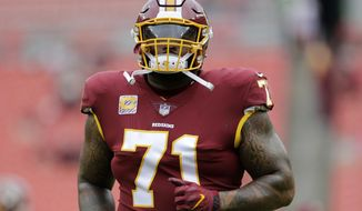 FILE - In this Oct. 17, 2017, file photo, Washington Redskins offensive tackle Trent Williams warms up prior to an NFL football game against the San Fransisco 49ers in Landover, Md. Thompson hopes he can play after missing the past six games with a fracture on each side of his rib cage. (AP Photo/Mark Tenally) ** FILE **
