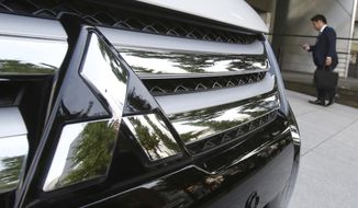 The logo of Mitsubishi Motors is seen at the automaker's headquarters in Tokyo, Monday, Nov. 26, 2018. The board of Mitsubishi Motors is meeting Monday to decide whether to oust Carlos Ghosn as chairman at the Japanese automaker, which is allied with Renault-Nissan.(AP Photo/Koji Sasahara)