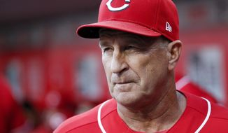 FILE - In this Sept. 29, 2018 file photo Cincinnati Reds interim manager Jim Riggleman works in the dugout in the eighth inning of a baseball game against the Pittsburgh Pirates in Cincinnati. Riggleman has been hired by the New York Mets as bench coach for Mickey Callaway. He replaces Gary DiSarcina, who is shifting to third base coach. New York, which announced the hiring Monday, Nov. 26, 2018 went 77-85 in Callaway's first season as a manager, and Callaway drew attention for game management. (AP Photo/John Minchillo)