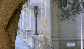 In this photo provided by WLBT-TV a noose hangs on a tree on the state capitol grounds in Jackson, Miss. on Monday, Nov. 26, 2018. A Mississippi official says two nooses and six signs were found on the grounds of the Mississippi state Capitol. Chuck McIntosh, a spokesman for the Mississippi Department of Finance and Administration, which oversees the Capitol, says the nooses and signs were found Monday morning between 7:30 a.m. and 8 a.m. (WLBT-TV via AP)