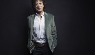 FILE - In this Nov. 14, 2016 file photo, Mick Jagger of the Rolling Stones poses for a portrait in New York. The Rolling Stones frontman, who will tour America next spring with his iconic band, says live shows give him a rush that can't be matched and is the reason that at 75, he still loves touring. (Photo by Victoria Will/Invision/AP, File)