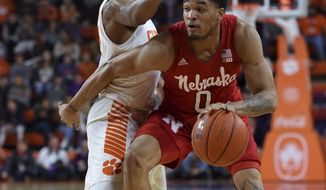 Nebraska's James Palmer Jr. dribbles while defended by Clemson's Clyde Trapp during the first half of an NCAA college basketball game Monday, Nov. 26, 2018, in Clemson, S.C. (AP Photo/Richard Shiro)