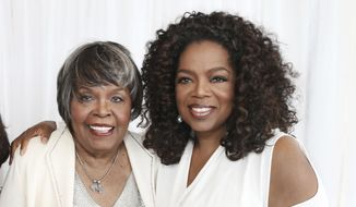 This image released by Harpo Inc. shows media mogul Oprah Winfrey, right, with her mother Vermita Lee. A Winfrey spokeswoman issued a statement, Monday, Nov. 26, 2018, saying Lee died at her Milwaukee home on Nov. 22. She was 83. (George Burns/Harpo Inc. via AP)