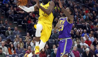 Indiana Pacers guard Tyreke Evans, left, drives to the basket as Utah Jazz forward Royce O'Neale, right, defends in the first half during an NBA basketball game Monday Nov. 26, 2018, in Salt Lake City. (AP Photo/Rick Bowmer)