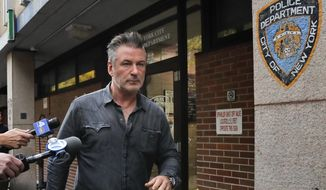 """In this Nov. 2, 2018, file photo, actor Alec Baldwin walks out of the New York Police Department's 10th Precinct, in New York, after he was arrested for allegedly punching a man in the face during a dispute over a parking spot outside his New York City home, authorities said. Baldwin is set to be arraigned in a New York court on assault and harassment charges Monday, Nov. 26, 2018. He has said that any assertion that he punched anyone over a parking spot is false and that the episode was """"egregiously misstated."""" (AP Photo/Julie Jacobson, File)"""