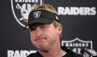 FILE - In this Sunday, Nov. 25, 2018, file photo, Oakland Raiders head coach Jon Gruden speaks at a news conference after an NFL football game against the Baltimore Ravens in Baltimore. The Raiders were unable to build off their second win of the season and are now assured of a losing record in Gruden's first season back as coach. (AP Photo/Nick Wass, File)