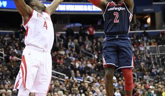 Washington Wizards guard John Wall (2) shoots against Danuel House (4) during overtime an NBA basketball game, Monday, Nov. 26, 2018, in Washington. The Wizards won 135-131 in overtime. (AP Photo/Nick Wass)