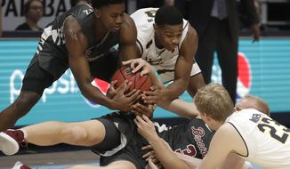 Santa Clara's Trey Wertz, top left, and Henrik Jadersten (3) wrestle for the ball against California's Paris Austin, top right, and Connor Vanover (23) during the second half of an NCAA college basketball game in Berkeley, Calif., Monday, Nov. 26, 2018. (AP Photo/Jeff Chiu)
