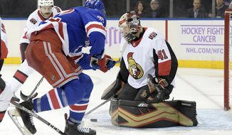 Ottawa Senators goaltender Craig Anderson (41) blocks the puck as New York Rangers center Filip Chytil (72) skates in during the second period of an NHL hockey game Monday, Nov. 26, 2018, at Madison Square Garden in New York. (AP Photo/Bill Kostroun)
