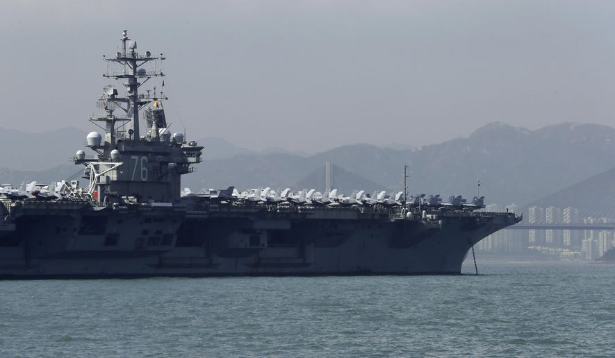 In this Wednesday, Nov. 21, 2018, file photo, the U.S. Navy's USS Ronald Reagan aircraft carrier is anchored in Hong Kong. (AP Photo/Kin Cheung) ** FILE **