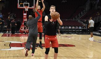 Chicago Bulls forward Lauri Markkanen (24) shoots free throws before an NBA basketball game against the San Antonio Spurs Monday, Nov. 26, 2018, in Chicago. . (AP Photo/David Banks)