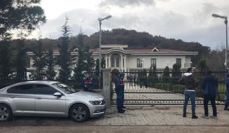 Paramilitary police officers stand at the entrance to a private villa in Yalova, Turkey, Monday, Nov. 26, 2018. Turkey's state-run news agency says police are searching a villa in northwest Turkey as part of an investigation into the killing of Saudi journalist Jamal Khashoggi.  (DHA via AP)