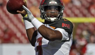 Tampa Bay Buccaneers quarterback Jameis Winston (3) throws a pass as he warms up before an NFL football game against the San Francisco 49ers Sunday, Nov. 25, 2018, in Tampa, Fla. (AP Photo/Chris O'Meara)