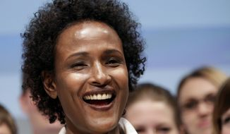 Model Waris Dirie from Somalia smiles after the presentation of the human rights logo competition in Berlin, Germany, Tuesday, May 3, 2011.  (AP Photo/Michael Sohn)