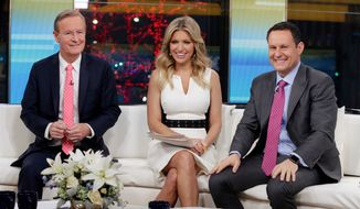 "In this Jan. 17, 2018, file photo, ""Fox & Friends"" co-hosts, from left, Steve Doocy, Ainsley Earhardt and Brian Kilmeade appear on their set in New York. (AP Photo/Richard Drew, File)"