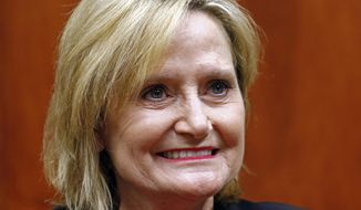 Mississippi Republican Sen. Cindy Hyde-Smith is photographed in a media sit-down in Ridgeland, Miss.  (AP Photo/Rogelio V. Solis, File)