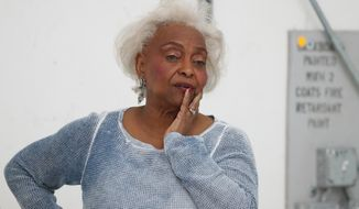 Broward County Supervisor of Elections Brenda Snipes watches workers do a hand recount at the Broward County Supervisor of Elections office, Friday, Nov. 16, 2018, in Lauderhill, Fla. Florida's acrimonious U.S. Senate contest is headed to a legally required hand recount after an initial review by ballot-counting machines showed Republican Gov. Rick Scott and Democratic Sen. Bill Nelson separated by fewer than 13,000 votes.  (AP Photo/Wilfredo Lee)