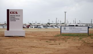 FILE - In this June 30, 2015, file photo, signs are seen at the entrance to the South Texas Family Residential Center in Dilley, Texas. Lawyers for the mother of a toddler who died several weeks after being released from the nation's largest family detention center have filed a legal claim seeking $60 million from the U.S. government for the child's death. Attorneys for Yazmin Juarez submitted the claim Tuesday, Nov. 27, 2018. (AP Photo/Eric Gay, File)