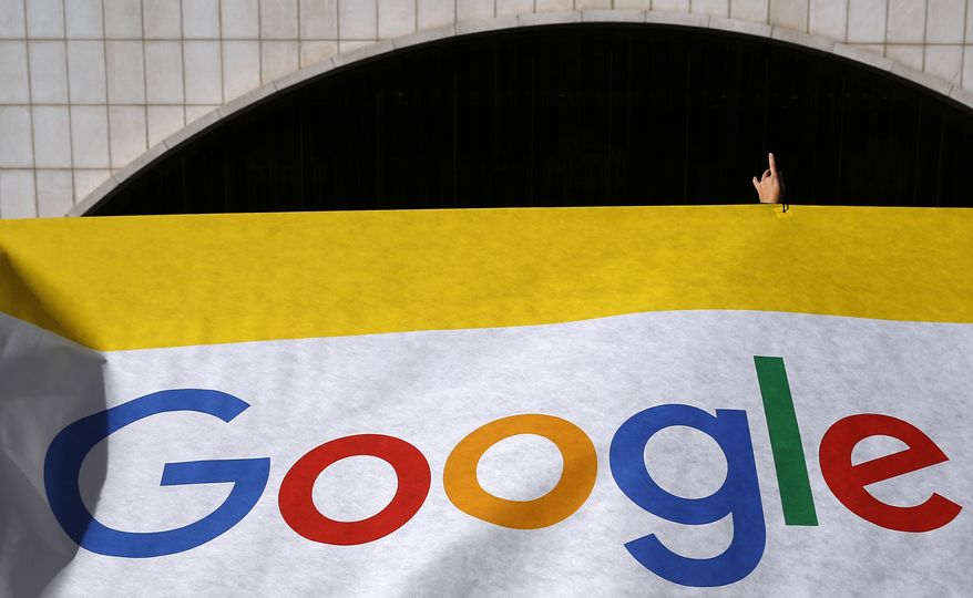 """An Amnesty International activist gestures during a protest against the China Google censorship in Madrid, Spain, Tuesday, Nov. 27, 2018. According to Amnesty International people who use Google in China will not be able to access services such as Wikipedia or Facebook. and words like """"human rights"""" will not give any results when entering them in the search engine. (AP Photo/Manu Fernandez)"""