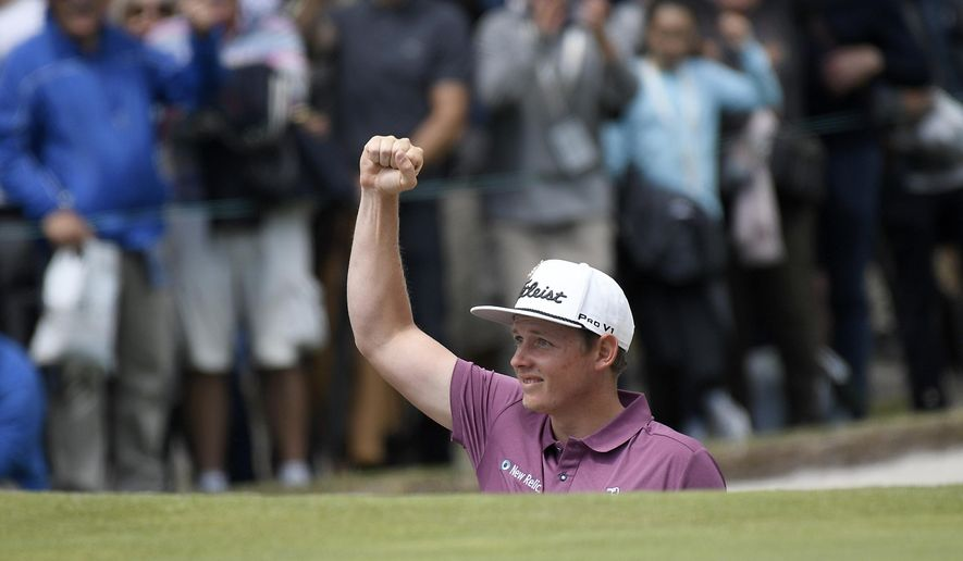 Australia's Cameron Smith reacts after hitting out of a bunker during the World Cup of Golf in Melbourne, Australia, Sunday, Nov. 25, 2018. (AP Photo/Andy Brownbill)