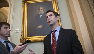 In this file photo, Sen. Tom Cotton, R-Ark., speaks to reporters as he arrives for a meeting with fellow Republicans, including Vice President Mike Pence and President Donald Trump's son-in-law, Jared Kushner, who are at the Capitol to discuss the nation's criminal justice sentencing laws, in Washington, Tuesday, Nov. 27, 2018. (AP Photo/J. Scott Applewhite) ** FILE **
