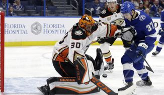 Anaheim Ducks goaltender Ryan Miller (30) makes a save on a shot by Tampa Bay Lightning center Yanni Gourde (37) during the second period of an NHL hockey game Tuesday, Nov. 27, 2018, in Tampa, Fla. (AP Photo/Chris O'Meara)