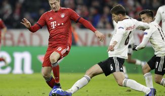 Bayern forward Robert Lewandowski, left, and Benfica's Ruben Dias challenge for the ball during the Champions League group E soccer match between FC Bayern Munich and Benfica Lisbon in Munich, Germany, Tuesday, Nov. 27, 2018. (AP Photo/Matthias Schrader)