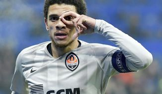 Shakhtar's Taison celebrates after scoring his side's second goal during the soccer Champions League match between 1899 Hoffenheim and Shakhtar Donetsk in Sinsheim, southern Germany, Tuesday, Nov. 27, 2018. (Uwe Anspach/dpa via AP)