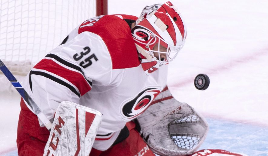 Carolina Hurricanes goaltender Curtis McElhinney makes a save against the Montreal Canadiens during the first period of an NHL hockey game Tuesday, Nov. 27, 2018, in Montreal. (Paul Chiasson/The Canadian Press via AP)