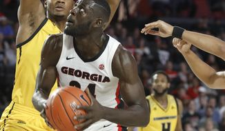 Georgia forward Derek Ogbeide (34) looks for a shot against Kennesaw State during an NCAA college basketball game in Athens, Ga., Tuesday, Nov. 27, 2018. (Jenn Finch/Athens Banner-Herald via AP)
