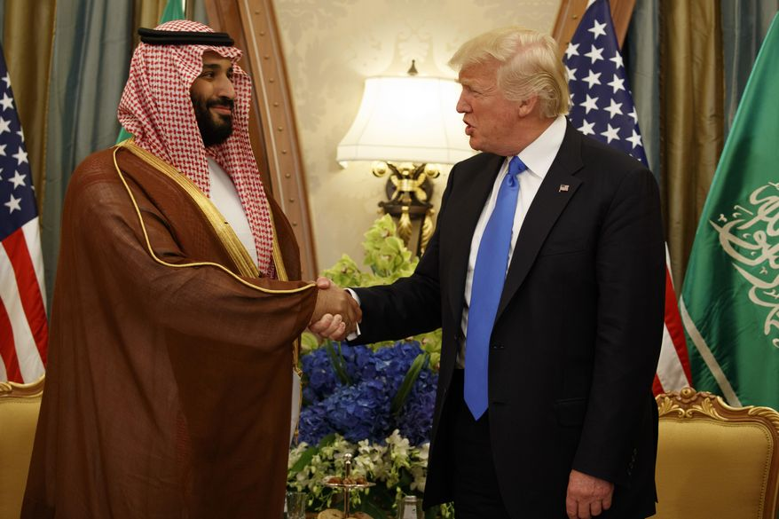 In this May 20, 2017, file photo, President Donald Trump shakes hands with Saudi Crown Prince Mohammed bin Salman, in Riyadh, Saudi Arabia. (AP Photo/Evan Vucci, File)