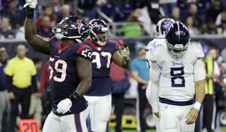 FILE - In this Monday, Nov. 26, 2018, file photo, Houston Texans outside linebacker Whitney Mercilus (59) celebrates after he sacked Tennessee Titans quarterback Marcus Mariota (8) during the second half of an NFL football game in Houston. The Titans have backed themselves into a corner with back-to-back losses, and now they need to fix issues on defense and the offensive line quickly to even have a chance to take advantage of playing four of their final five games at home starting Sunday hosting the Jets.  (AP Photo/David J. Phillip, File)