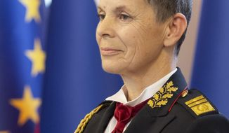 In this Nov. 23, 2018 photo provided Tuesday, Nov. 27, 2018 by Slovenia's Defense Ministry, Maj. Gen. Alenka Ermenc pose for a photograph in Ljubljana, Slovenia. Slovenia's government has appointed a female officer to become the new chief of staff of the army for the first time in the small NATO and European Union member country. (Bruno Toic/Slovenian Defense Ministry via AP)