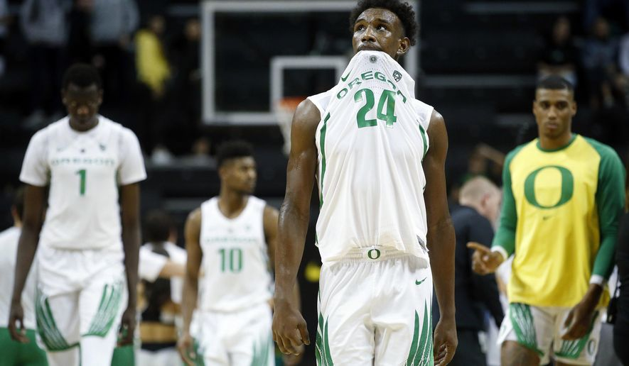 Oregon forward Abu Kigab walks off the court with his teammates after the team was defeated by Texas Southern in an NCAA college basketball game in Eugene, Ore., Monday, Nov. 26, 2018. Texas Southern won, 89-84. (Andy Nelson/The Register-Guard via AP)