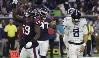 Houston Texans outside linebacker Whitney Mercilus (59) celebrates after he sacked Tennessee Titans quarterback Marcus Mariota (8) during the second half of an NFL football game, Monday, Nov. 26, 2018, in Houston. (AP Photo/David J. Phillip)